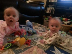 twin baby stealing her sister's toys