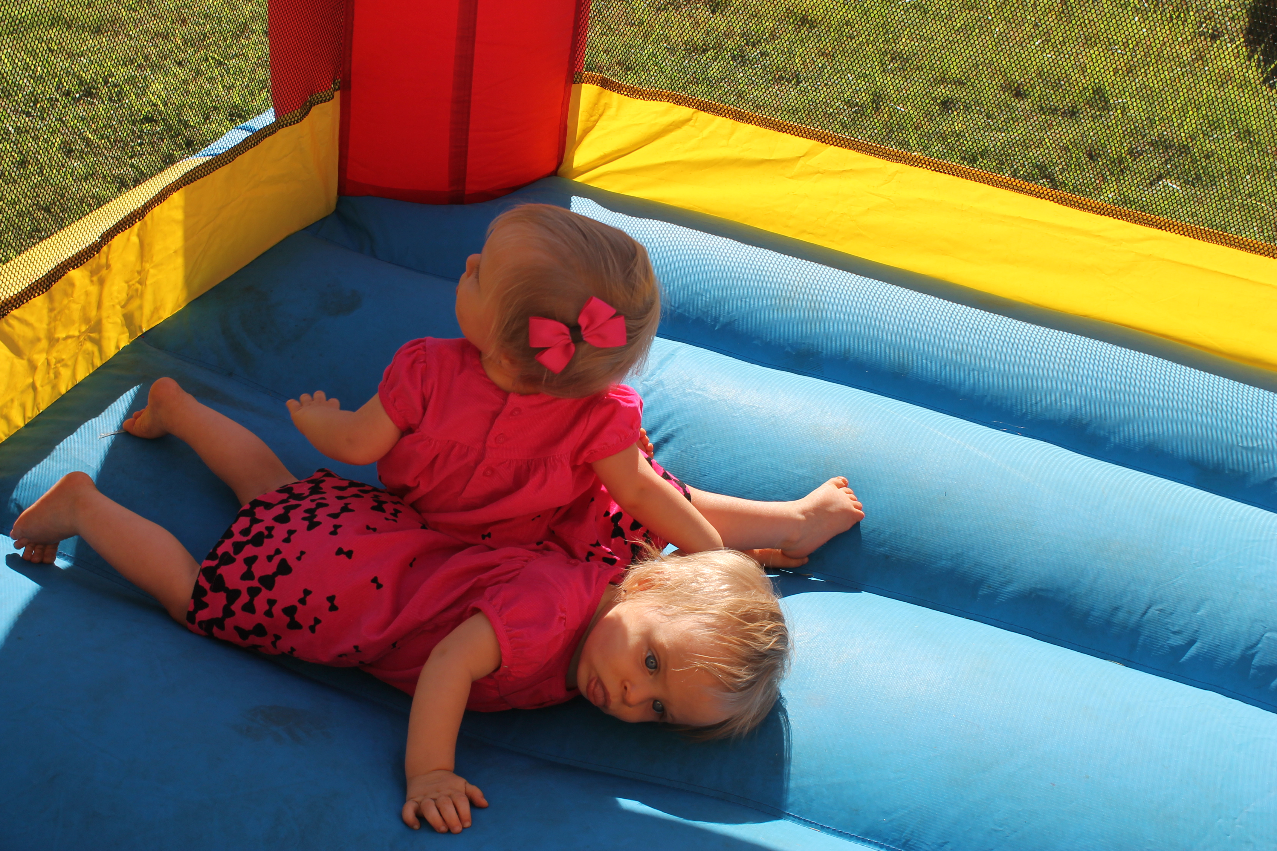 twin girls tired in a bounce house