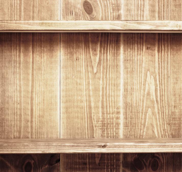 Empty shelf on wooden background. Wood texture.
