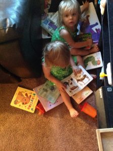 twins in nook reading