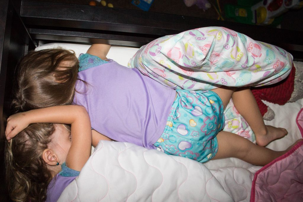 twins sleeping together