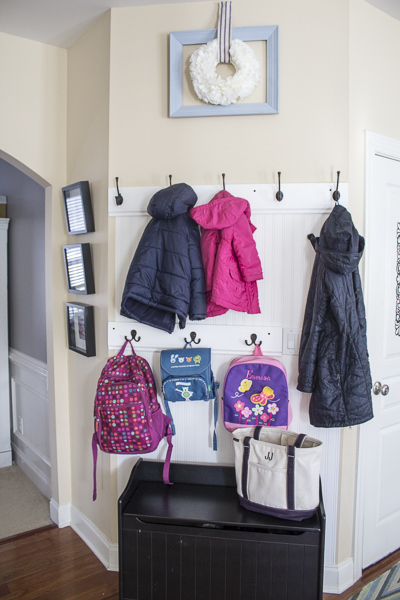 tips for keeping a tidy home-organized mud area entryway