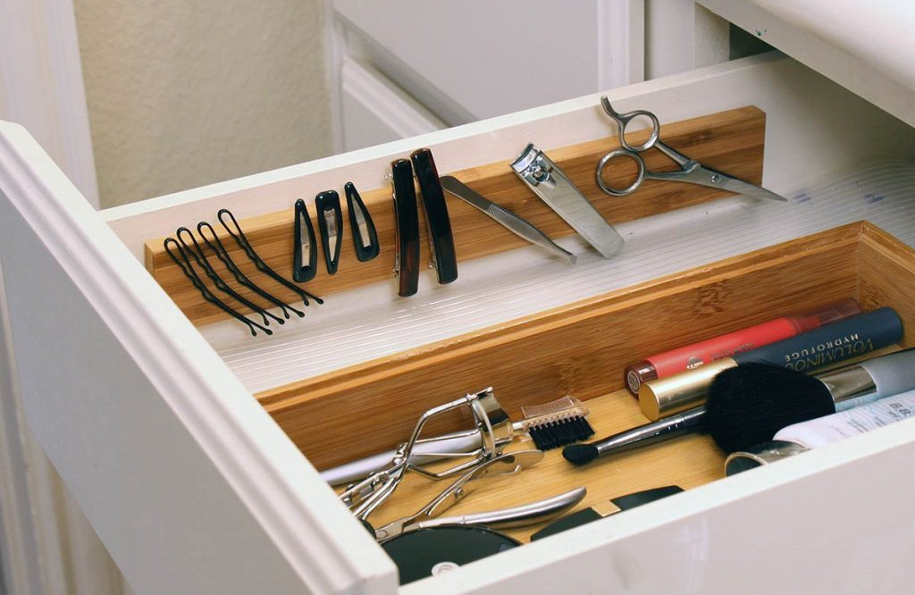 using magnetic strips to make easy diy bathroom organization solutions