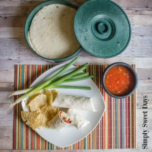 A quick and easy dinner idea for any day of the week! Homemade chicken and black bean burritos.