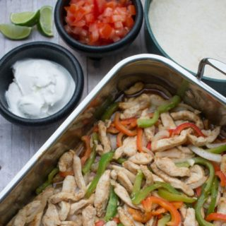 One of our favorite dinners for a busy night: Oven baked chicken fajitas! It's so easy and healthy, with chicken breasts and fresh veggies. It all goes in one pan, kinda like a casserole ;) If you're looking for a fresh take on chicken dinner ideas, this is it!