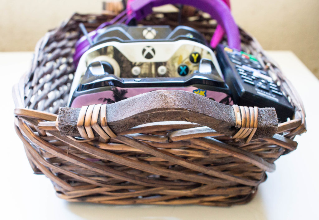 decorative basket to hold TV accessories