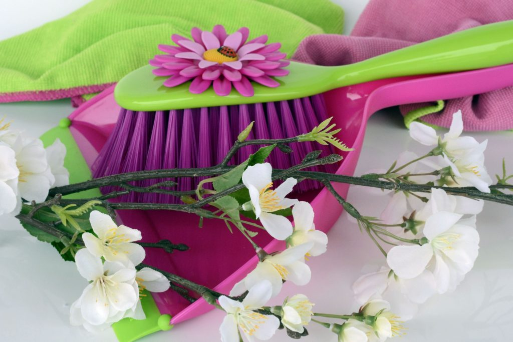 hand broom and dustpan with flowers