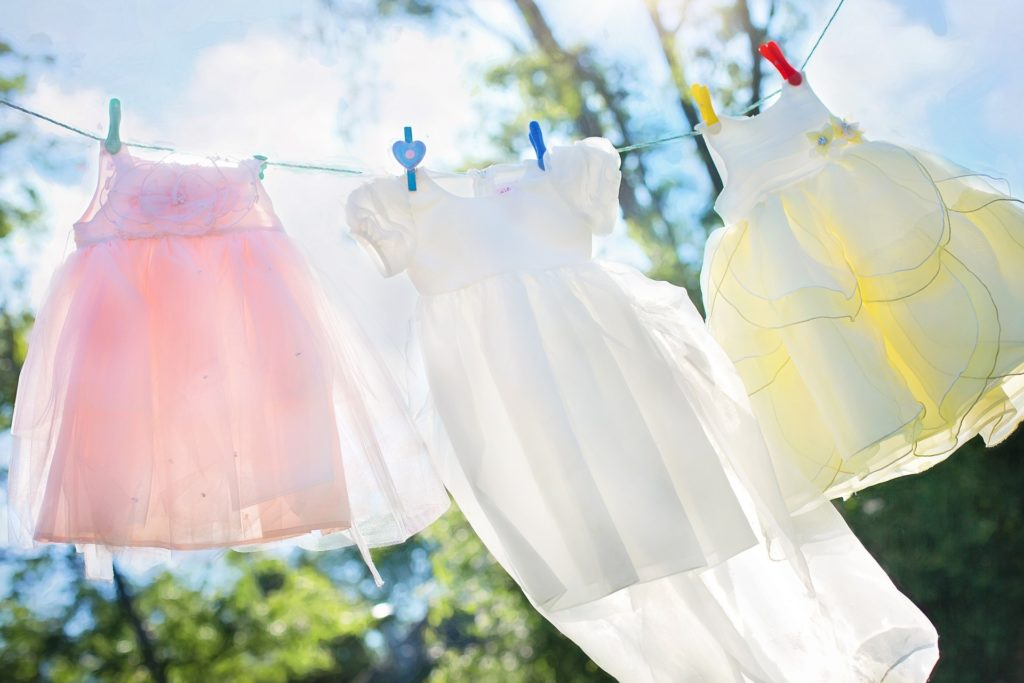 bright dresses hanging out to dry