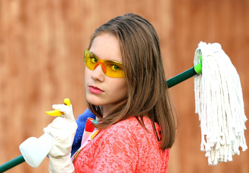 girl with mop and cleaning gloves
